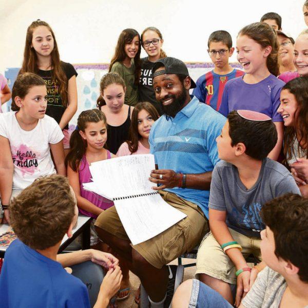 Harlem Hebrew teacher Jared Waters teaching English in Israel.